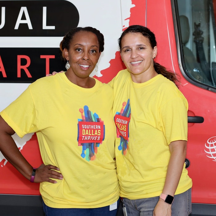two PepsiCo-FritoLay employees volunteering