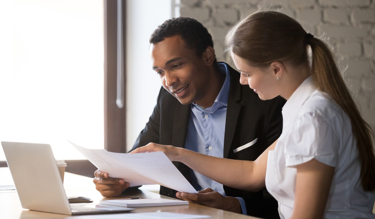 couple look over documents happily