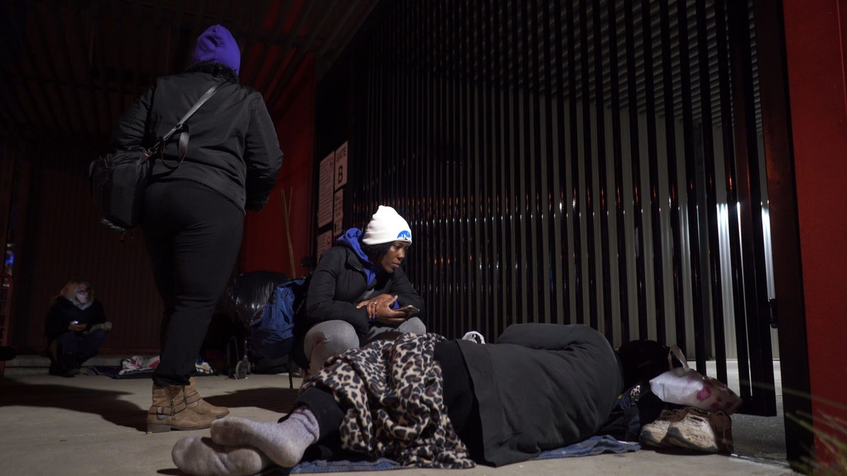 woman volunteer talks with a homeless person