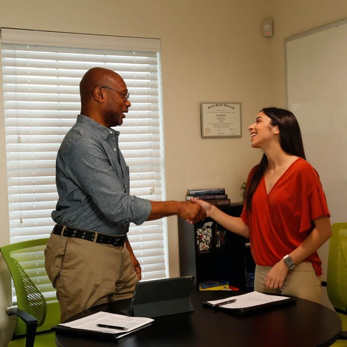 woman shaking mans hand, employment opportunity