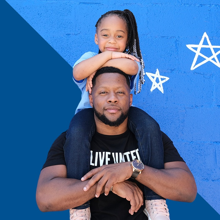 Daughter on shoulders of father Live United
